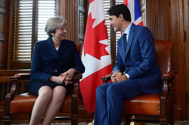 British Prime Minister Theresa May meets with Prime Minister Justin Trudeau in his office on Parliament Hill in Ottawa on Sept. 18 (Sean Kilpatrick/The Canadian Press)
