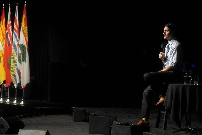 Prime Minister Justin Trudeau takes questions from the audience following his Symons Lecture speech at the Confederation Centre of the Arts in Charlottetown, P.E.I., on Thursday. (Nathan Rochford/The Canadian Press)