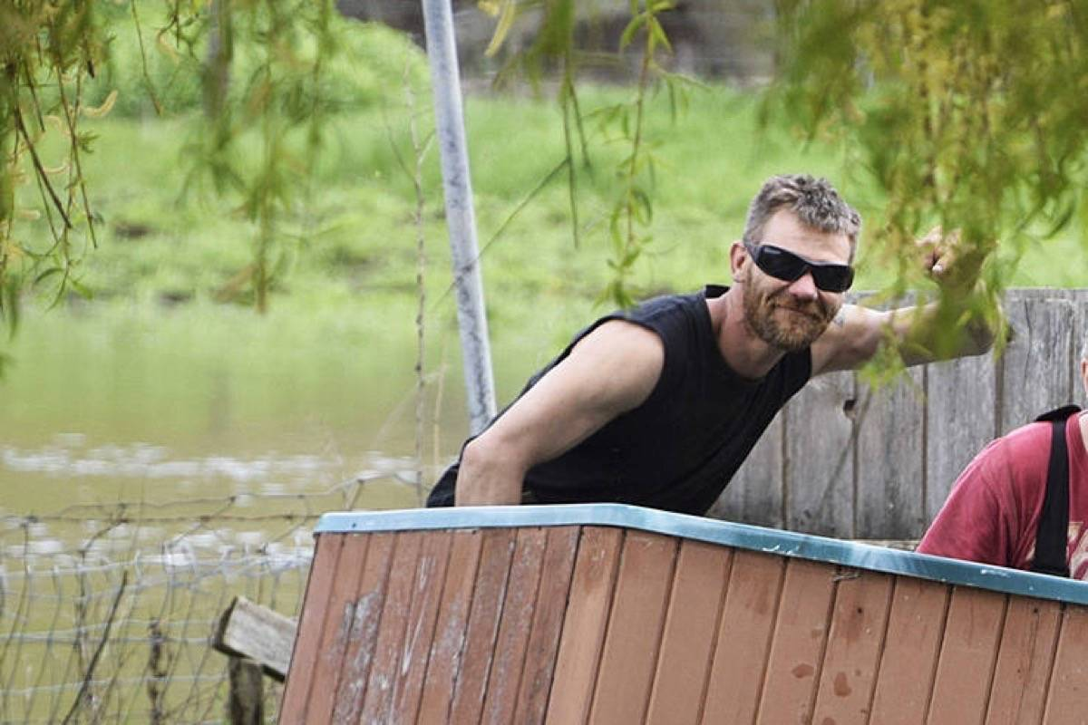 Curtis Sagmoen seen while helping neighbours deal with floods in Salmon Arm. (Black Press)
