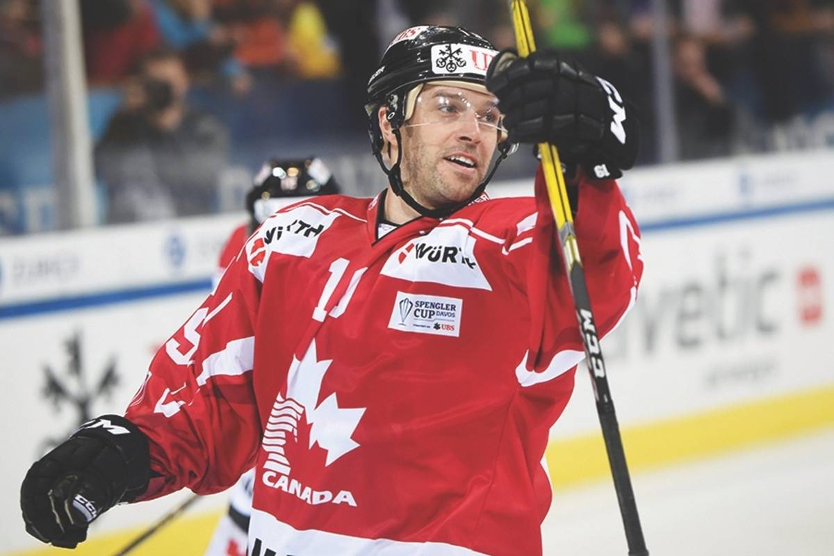 Canada's Andrew Ebbett celebrates after scoring his side's second goal during the game between Team Canada and HC Davos at the 91st Spengler Cup ice hockey tournament in Davos, Switzerland, Thursday, Dec. 28, 2017. (Melanie Duchene/Keystone via AP)