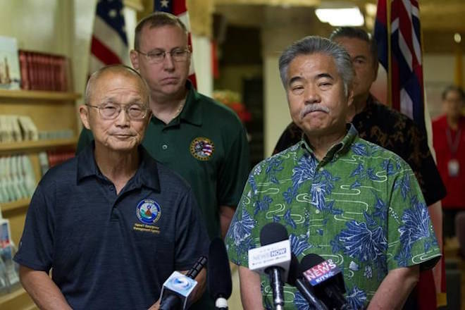 Vern Miyagi, Administrator, HEMA, left, and Hawaii Gov. David Ige addressed the media Saturday, Jan. 13, 2018, during a press conference at the Hawaii Emergency Management Center at Diamond Head Saturday following the false alarm issued of a missile launch on Hawaii. A push alert that warned of an incoming ballistic missile to Hawaii and sent residents into a full-blown panic was a mistake, state emergency officials said. (George F. Lee /The Star-Advertiser via AP)