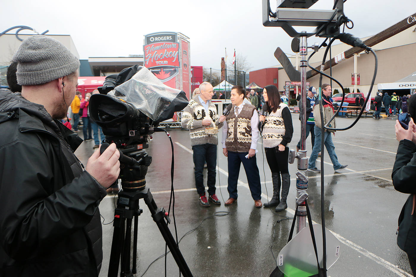 Rogers Hometown Hockey co-hosts Ron MacLean and Tara Slone film a segment with Cowichan Tribes Councillor Craig George on the festival site outside the Island Savings Centre on Sunday. (Kevin Rothbauer/Citizen)