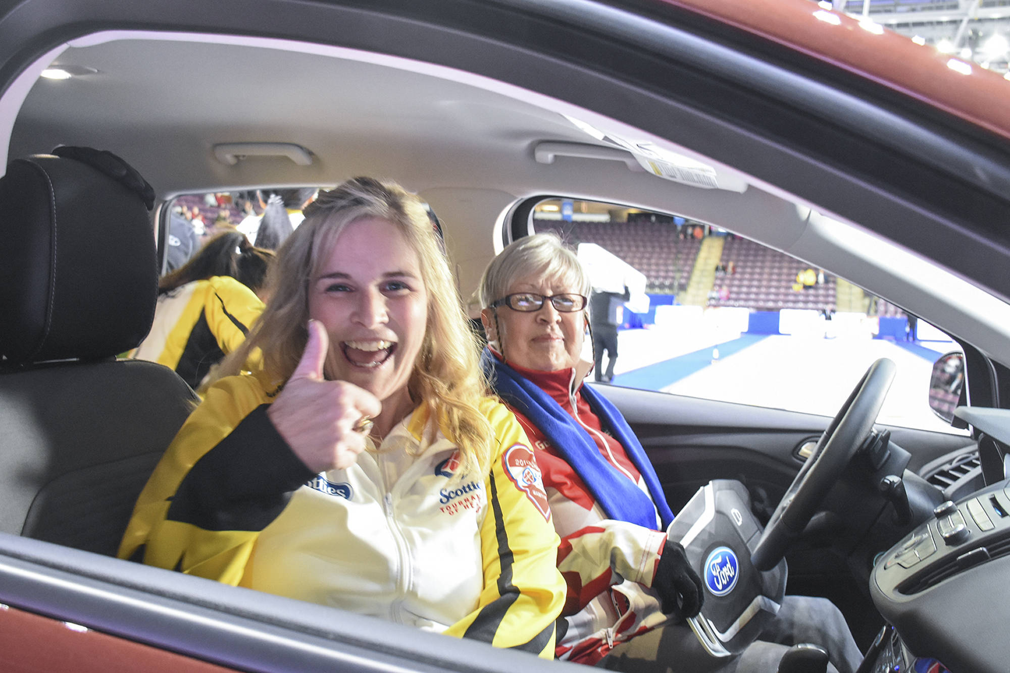 Jennifer Jones gives the thumbs up after winning the Ford Hot Rocks event that earned her team $15,000 and Penticton's Arlene Kolundzic a two-year lease on a Ford Escape SE.                                Mark Brett/Western News