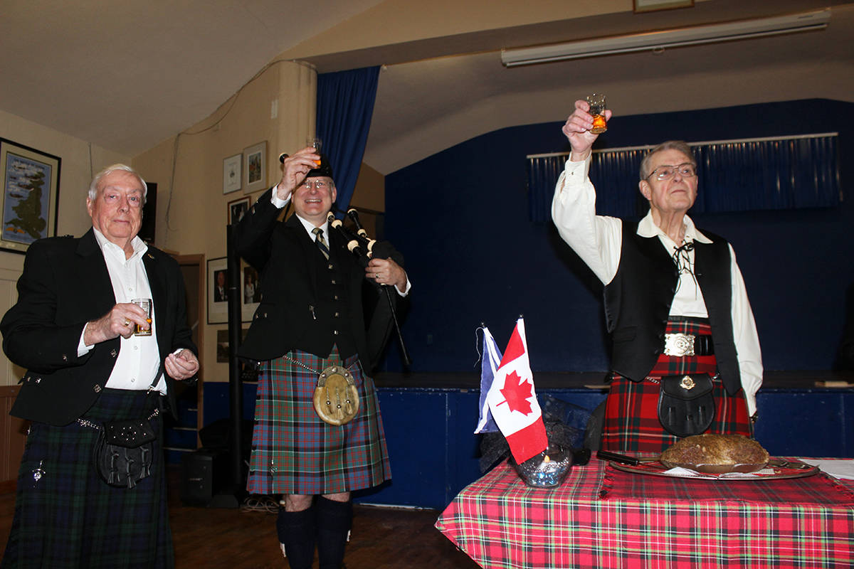 A toast is made by Wes Everitt, Rod Booth and Keith Falconer.