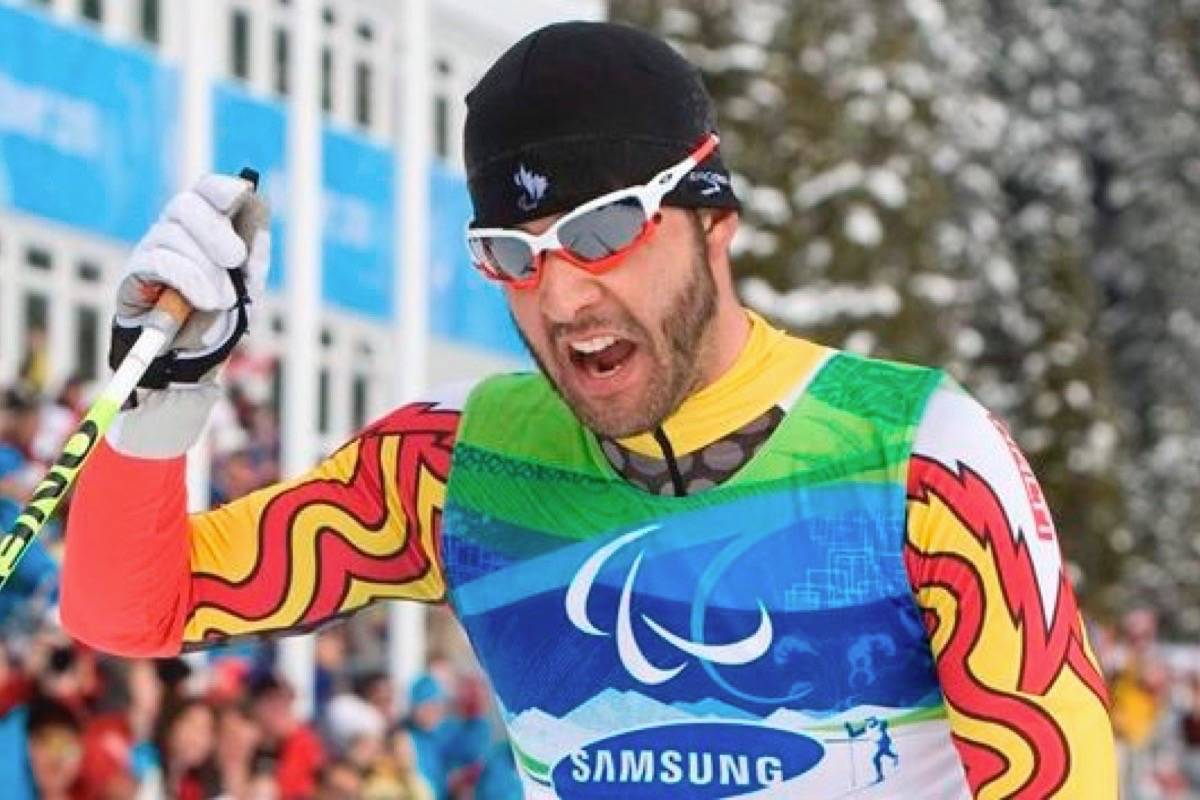 Canadian Brian McKeever celebrates his gold medal win in the men's 20 km free, visually impaired cross country ski race at the 2010 Winter Paralympic Games in Vancouver. (Jonathan Hayward/The Canadian Press)