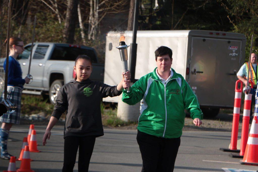 Gymnast Brooklyn Stobbe and bowler Jenny Scholefield bring in the torch to begin the 100-day countdown to the 2018 B.C. Summer Games in the Cowichan Valley. (Kevin Rothbauer/Citizen)