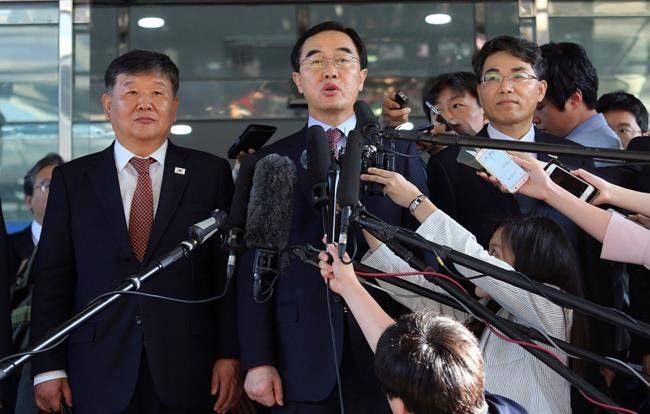 FILE - In this June 1, 2018, file photo, South Korean Unification Minister Cho Myoung-gyon, center, speaks to the media before leaving for the border village of Panmunjom to attend South and North Korean meeting, at the Office of the South Korea-North Korea Dialogue in Seoul, South Korea. (AP Photo/Ahn Young-joon, File)