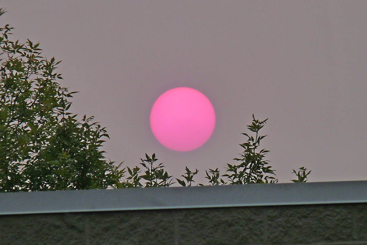 The sun glows a sickly red over Langley City, the result of the haze from wildfires. Dan Ferguson Langley Times