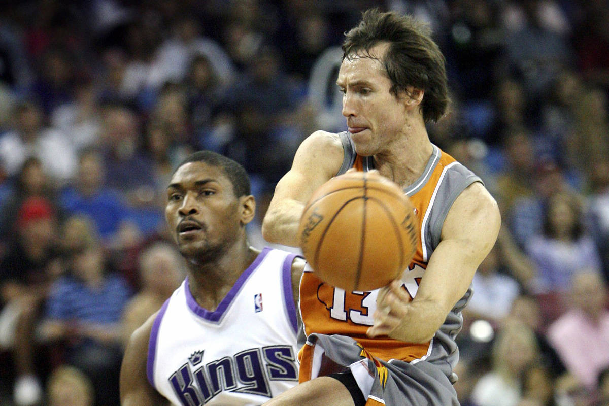 In this March 25, 2007, file photo, Phoenix Suns guard Steve Nash, right, drives around Sacramento Kings defender Ron Artest during the first half of an NBA basketball game in Sacramento, Calif. Nash, Jason Kidd and Grant Hill are among the 13-member class that will be inducted into the Basketball Hall of Fame in September, the Hall of Fame announced Saturday, March 31, 2018. (AP Photo/Steve Yeater, File)