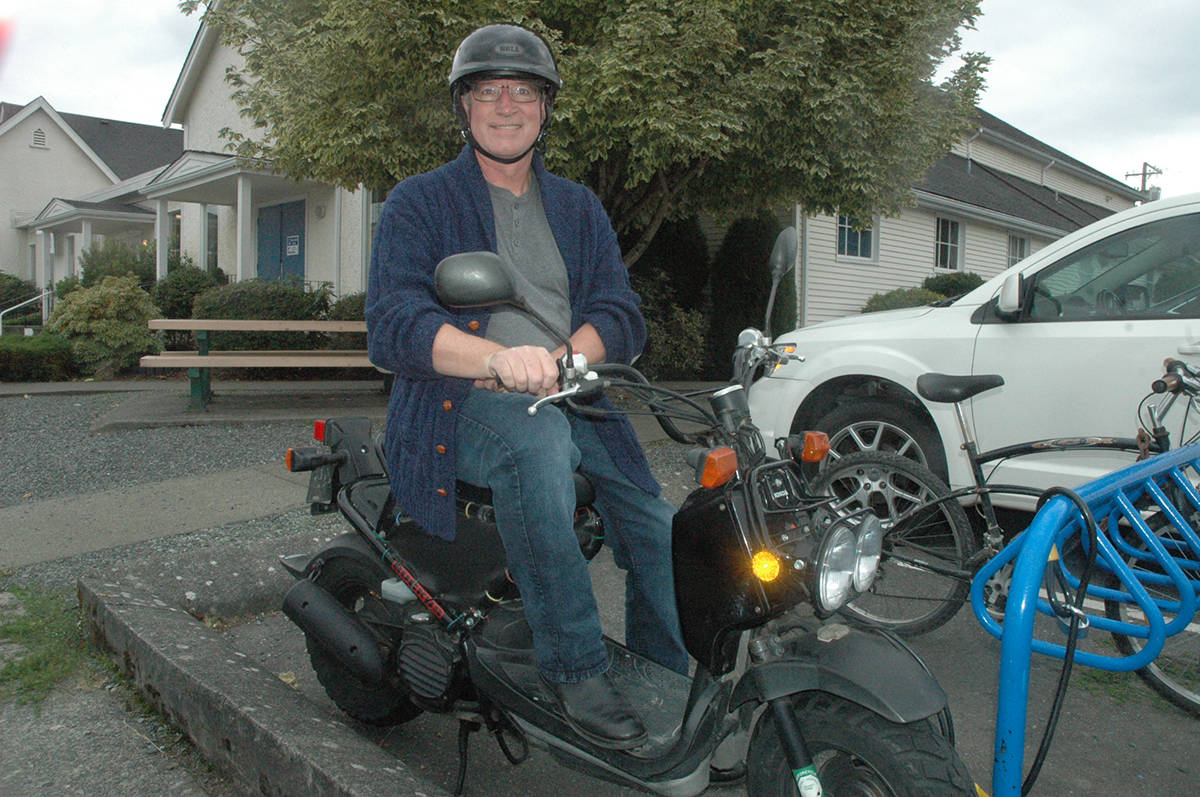 Keith Simmonds, a minister at Duncan United Church, is glad to have his scooter back after it was stolen over the weekend. (Robert Barron/Citizen)