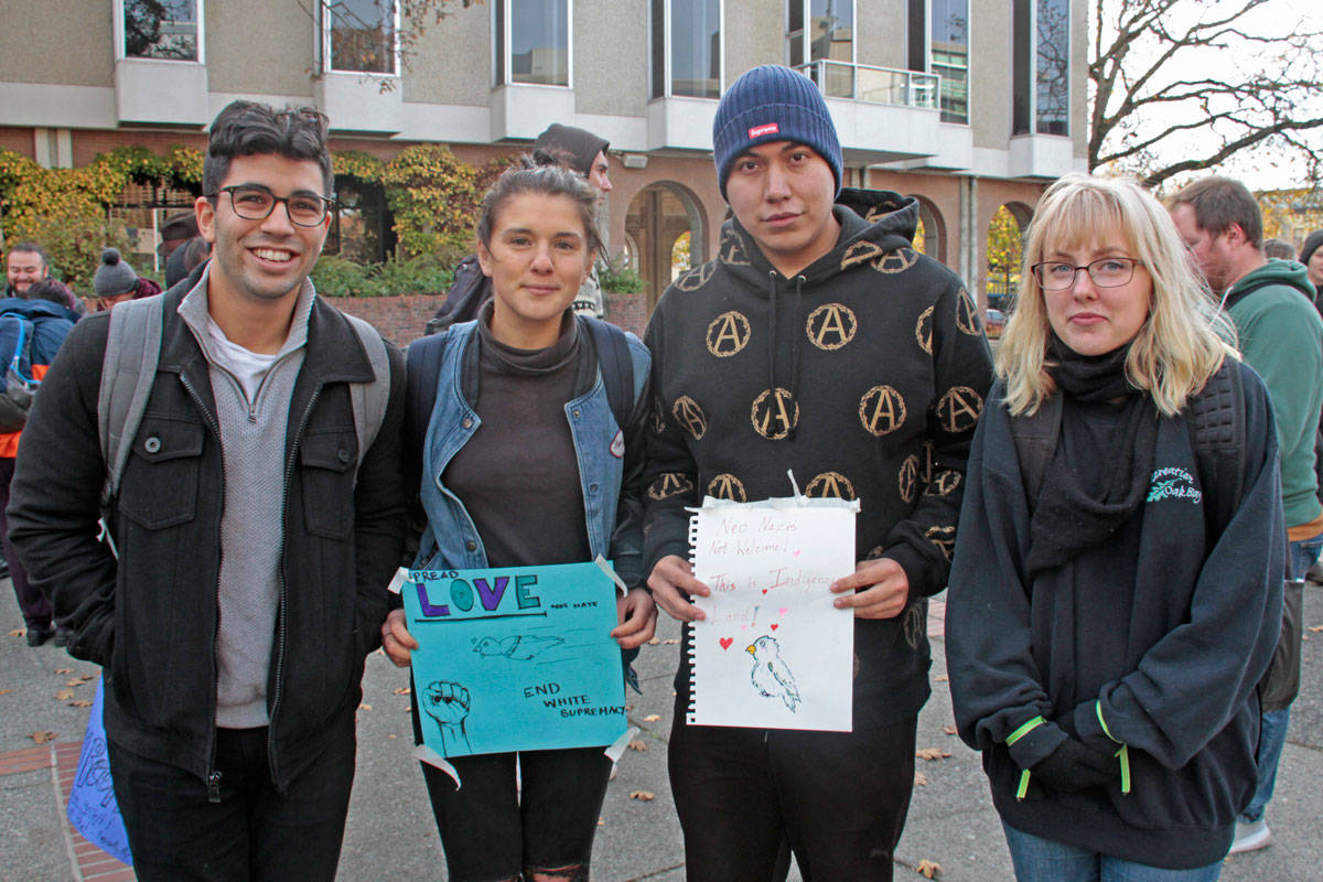 Roshon Nandhra, Jess Burgoyne-King, Brandon Dennis and Avria Crystal helped make posters in Centennial Square on Nov. 12. Dennis said he wanted to show neo-nazis aren't welcome on Vancouver Island. (Keili Bartlett/News staff)