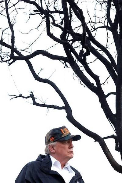 President Donald Trump spends a moment with his thoughts while touring damage from the Woolsey Fire in Malibu, Calif., on Saturday, Nov. 17, 2018. (Genaro Molina/Los Angeles Times via AP, Pool)