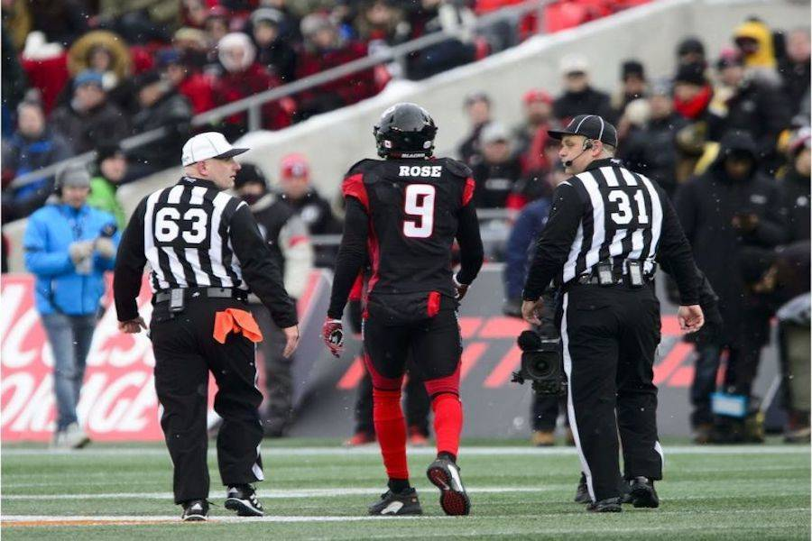 Ottawa Redblacks' Jonathan Rose (9) is escorted off the field while taking on the Hamilton Tiger-Cats during first half CFL East Division final action on Sunday, Nov. 18, 2018. SEAN KILPATRICK / AP