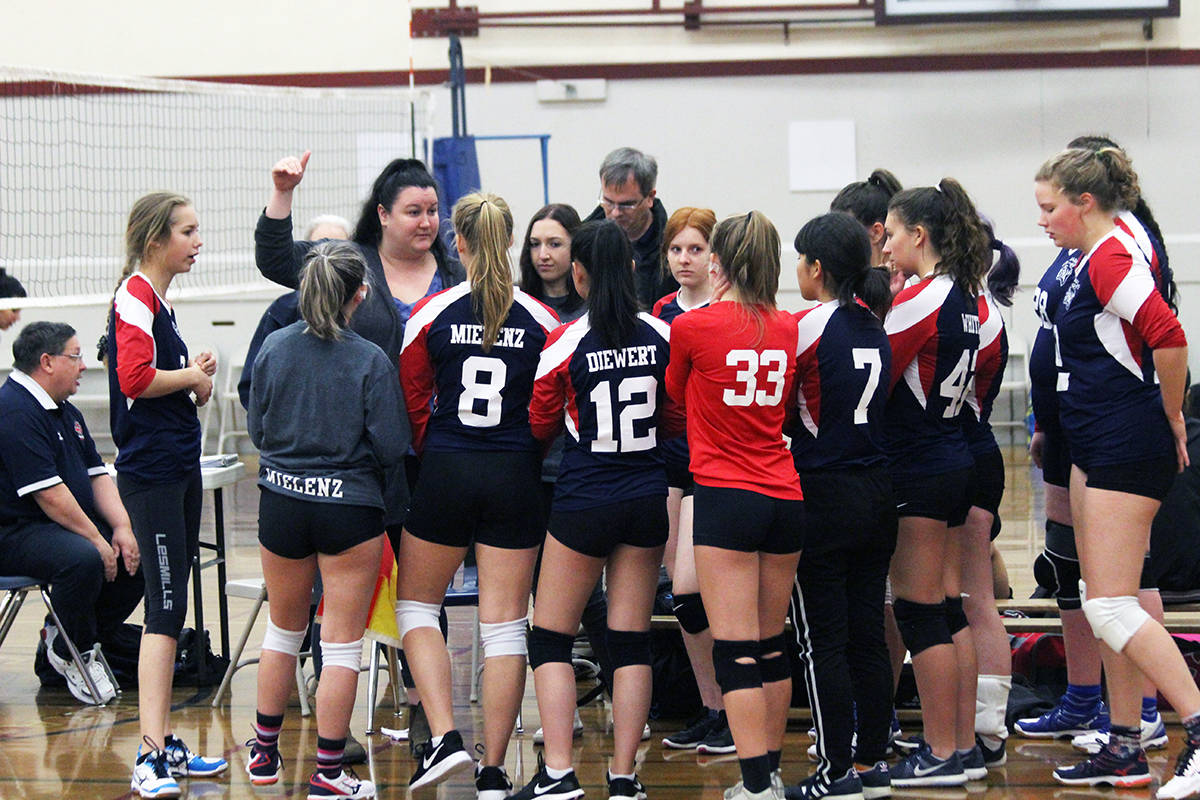 Chemainus Cougars senior girls volleyball coach Kelsey Bell makes some pointers to her players during a time-out. (Photo by Don Bodger)