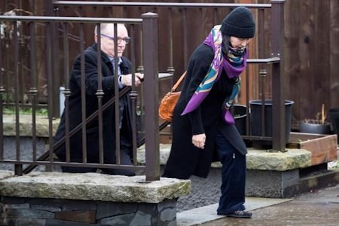 Huawei chief financial officer Meng Wanzhou, leaves her home with a security guard in Vancouver on Wednesday, December 12, 2018. THE CANADIAN PRESS/Jonathan Hayward