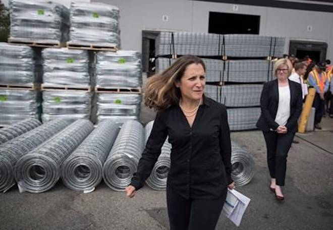 Minister of Foreign Affairs Chrystia Freeland, front, leaves a news conference after touring Tree Island Steel, in Richmond, B.C., on Friday, Aug. 24, 2018. THE CANADIAN PRESS/Darryl Dyck
