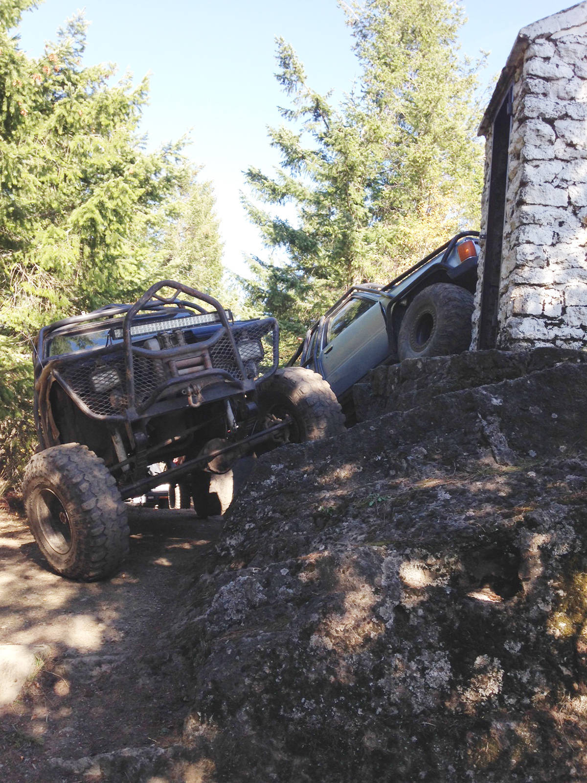 The province has decided to get involved in finding ways to protect the memorial cairn on top of Mount Prevost after these off-road vehicles were spotted with their front tires almost touching it in October. (Submitted photo)