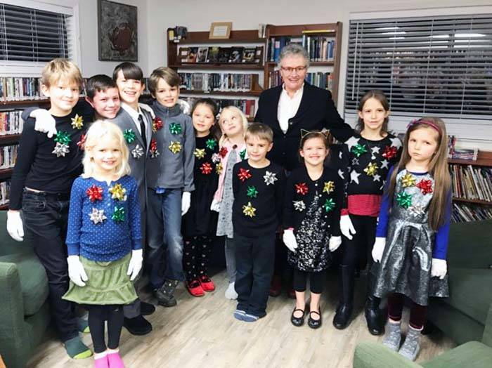 Teacher Genny Redman backstage with the kids in the Thetis Island Christmas concert before their performance of Silent Night, both sung and in sign language. (Photo by Kelly Bannister)