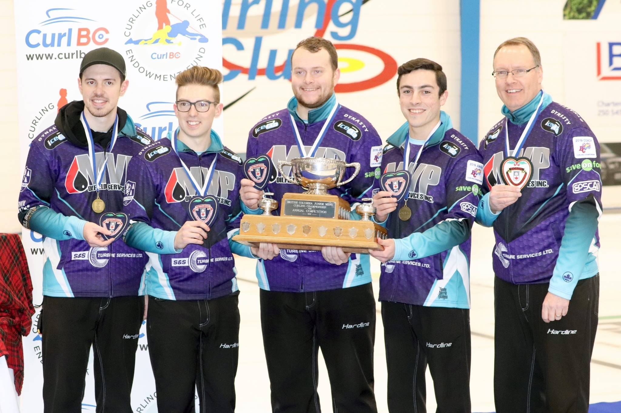 Team Tardi, from left, skip Tyler Tardi, third Sterling Middleton, second Matthew Hall, lead Alex Horvath and coach Paul Tardi show off their hardware after winning the BC provincial junior curling championships in Vernon on Tuesday, Jan. 1, 2019. (John K. White/Morning Star)