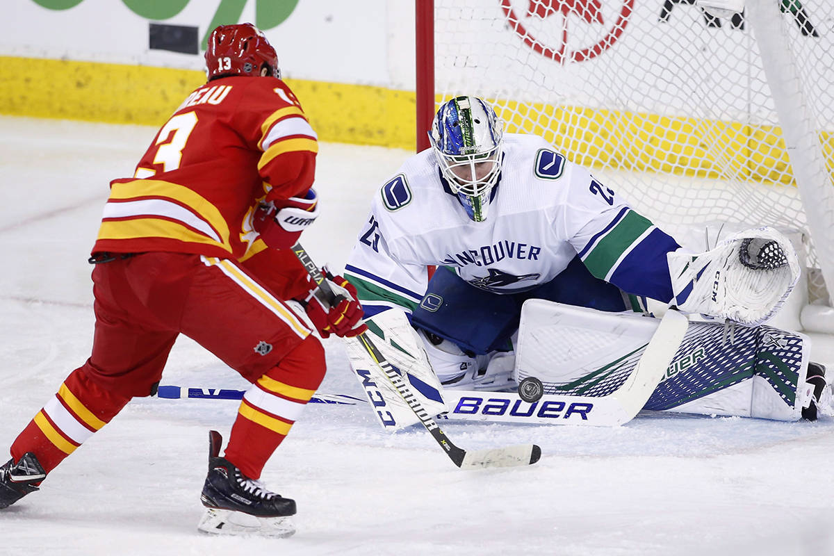 Vancouver Canucks goalie Jacob Markstrom, from Sweden, makes a save against Calgary Flames' Johnny Gaudreau during second period NHL action in Calgary, Saturday, Dec. 29, 2018. THE CANADIAN PRESS/Larry MacDougal