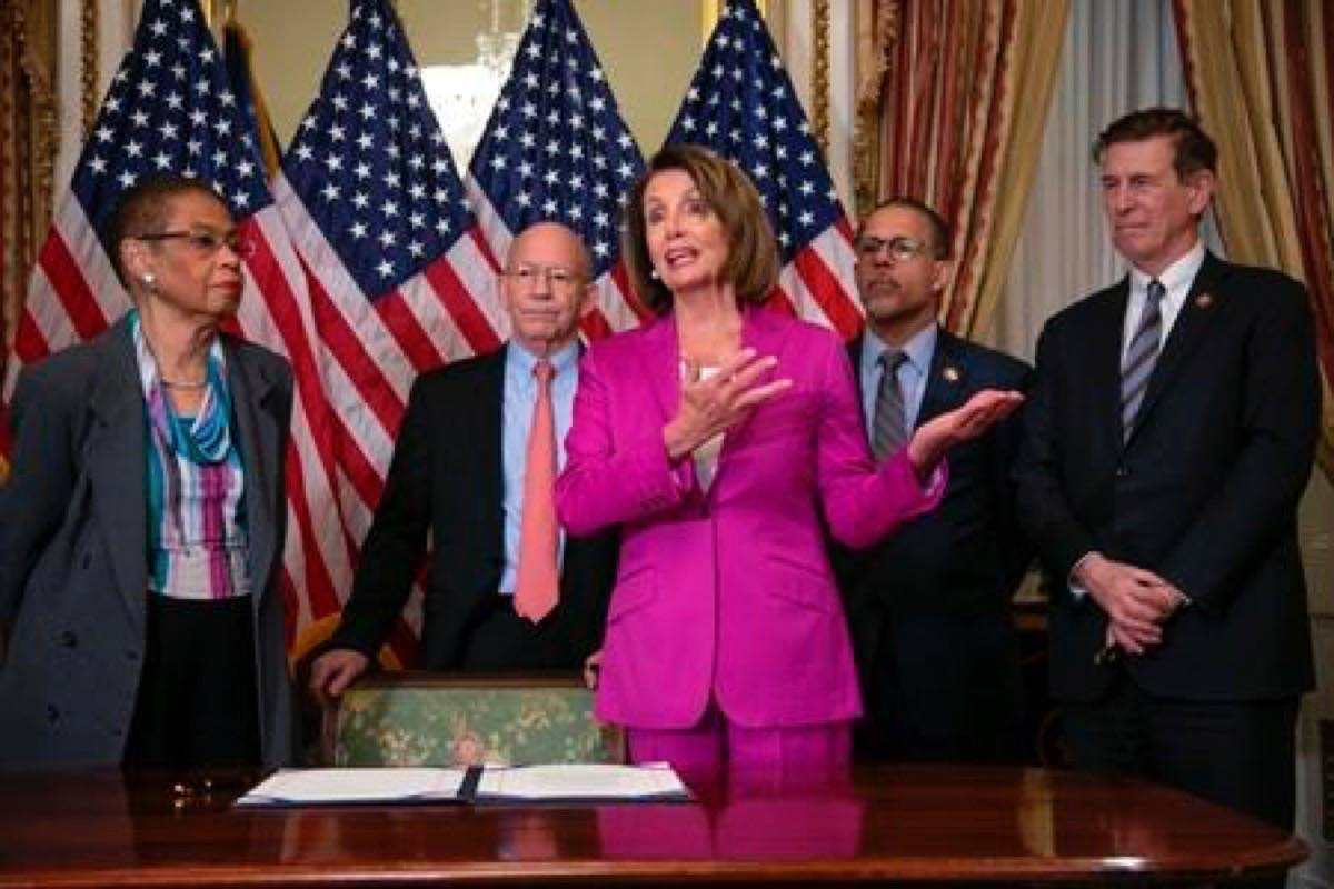 Speaker of the House Nancy Pelosi, D-Calif., talks to reporters after signing a House-passed a bill requiring that all government workers receive retroactive pay after the partial shutdown ends, at the Capitol in Washington, Friday, Jan. 11, 2019. She is joined by, from left, Delegate Eleanor Holmes Norton, D-D.C., Rep. Peter DeFazio, D-Ore., Rep. Anthony Brown, D-Md., and Rep. Don Beyer D-Va. (AP Photo/J. Scott Applewhite)