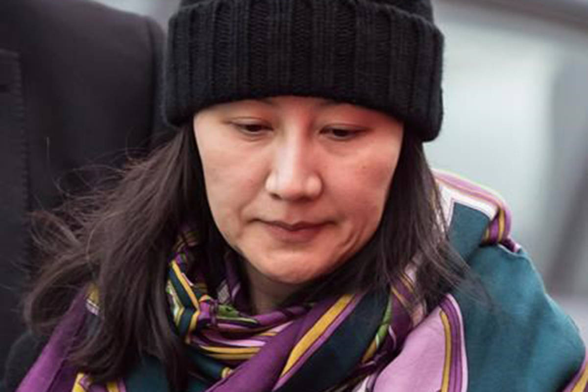 Huawei chief financial officer Meng Wanzhou is escorted by her private security detail while arriving at a parole office, in Vancouver, on Wednesday December 12, 2018. American authorities are facing a key deadline at the end of the month to formally request the extradition of Huawei executive Meng Wanzhou from Canada to the United States. THE CANADIAN PRESS/Darryl Dyck