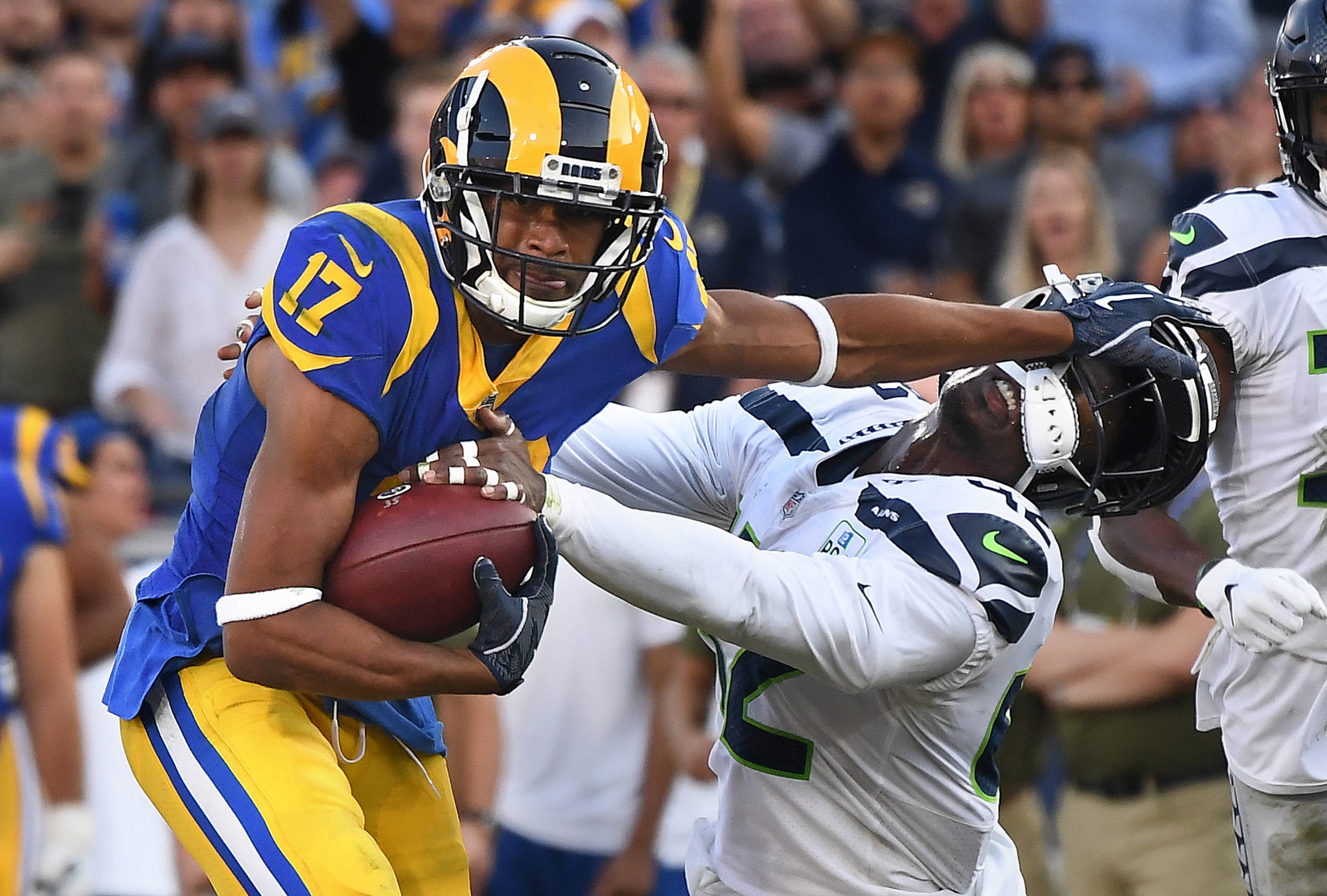 Los Angeles Rams receiver Robert Woods stiff-arms Seattle Seahawks safety Delano Hill to pick up yards in the third quarter on Sunday, Nov. 11, 2018 at the Coliseum in Los Angeles, Calif. (Wally Skalij/Los Angeles Times/TNS)