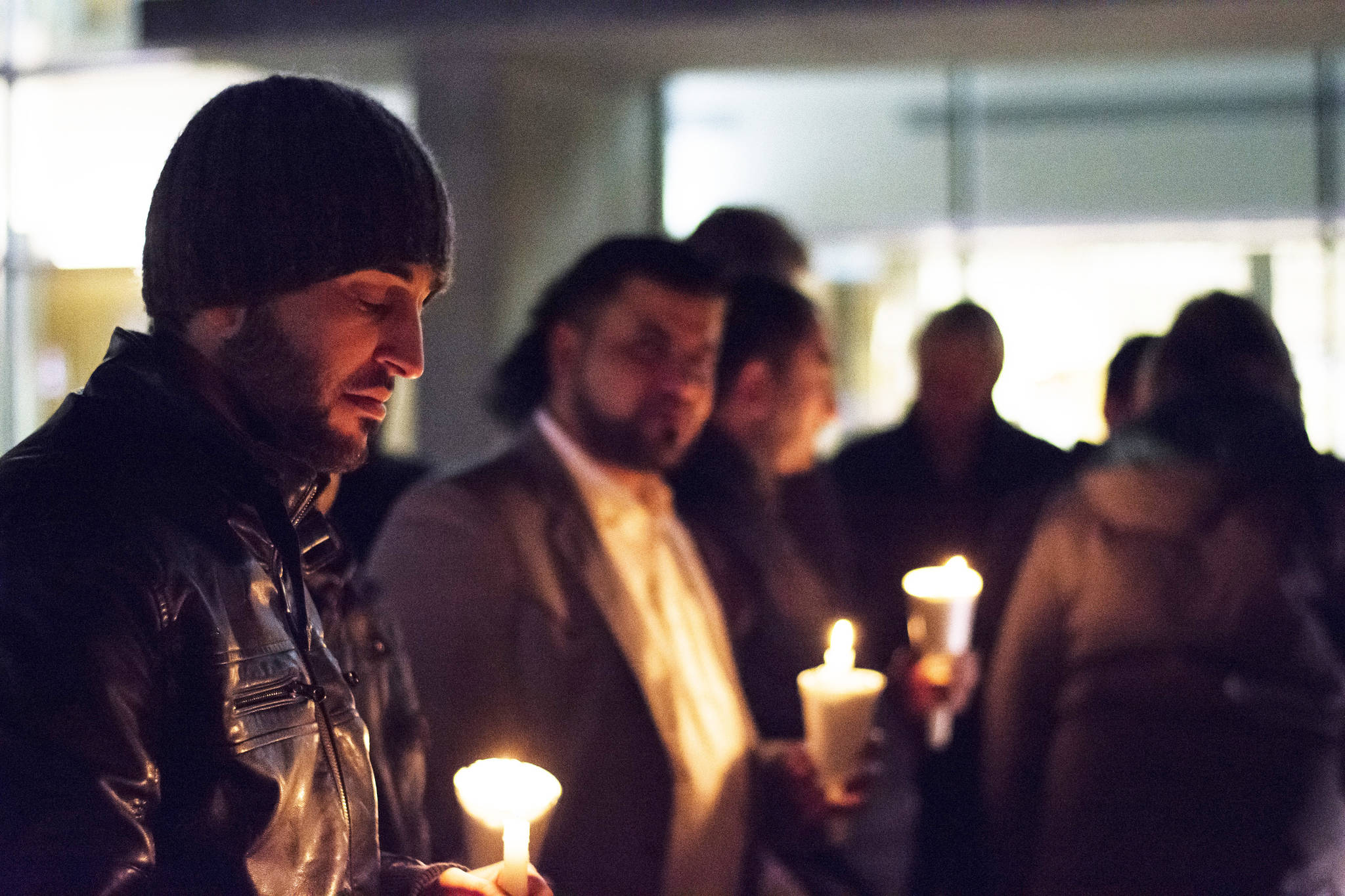 Mustafa Zakreet, Salmon Arm's first Syrian Refugee has a moment of reflection at the vigil for the victims of the Quebec City mosque shooting on Monday, Jan. 30.