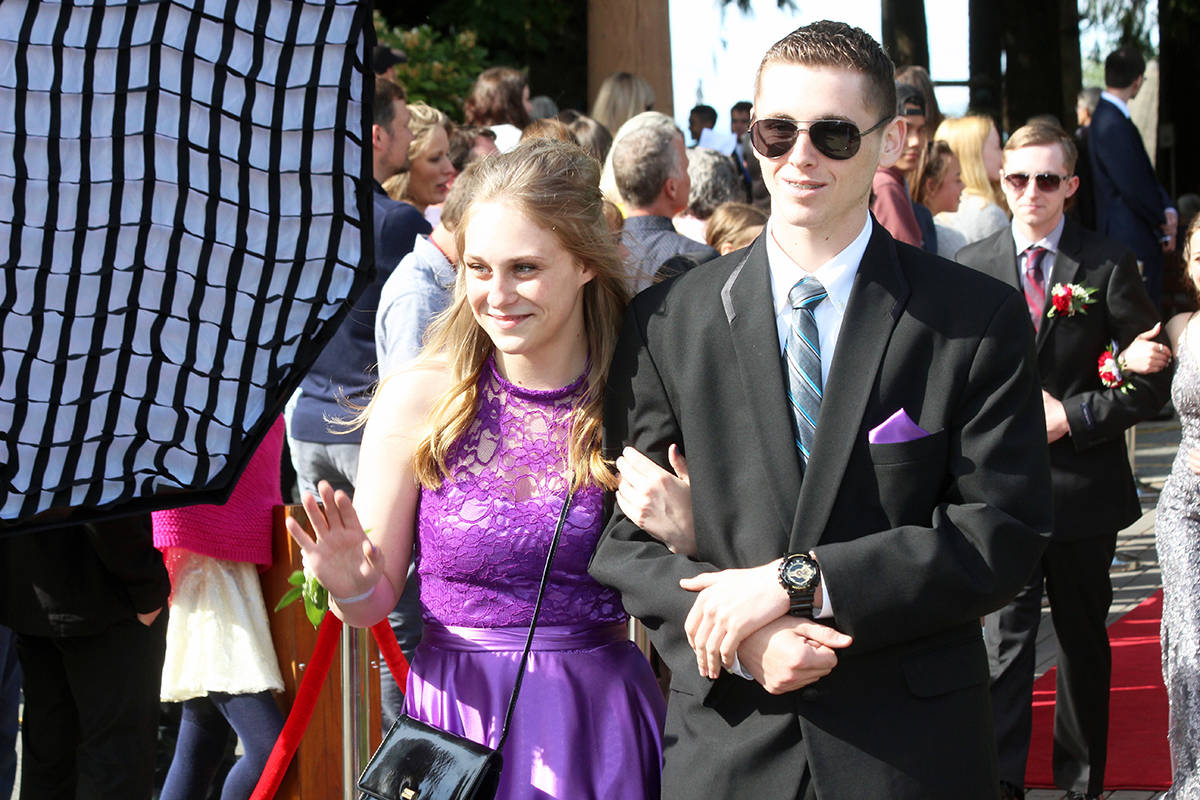 Grad Sam Price with guest Taylor Langtry. (Photo by Don Bodger)