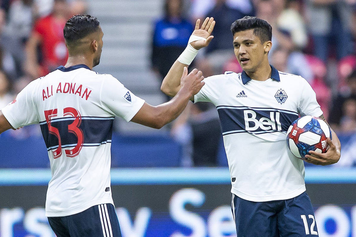 Vancouver Whitecaps' Fredy Montero (12) celebrates his goal against the Colorado Rapids with teammate Ali Adnan (53) during the first half of an MLS soccer game in Vancouver on Saturday, June 22, 2019. THE CANADIAN PRESS/Ben Nelms