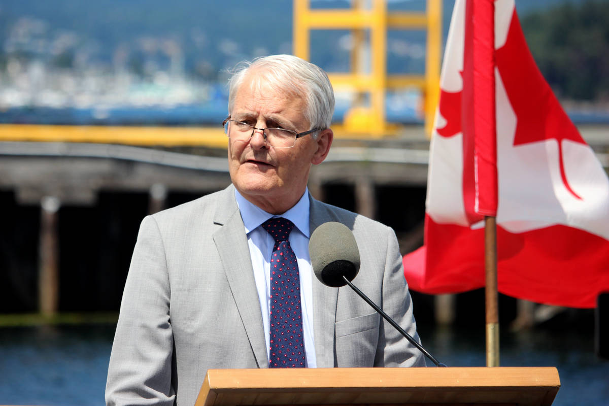Marc Garneau, minister of transportation and infrastructure, speaks during a funding announcement on Wednesday at the Port of Nanaimo's cruise ship terminal. Garneau announced that the federal government is investing $46.2 million to expand the Nanaimo Port Authority's Duke Point operations. (NICHOLAS PESCOD/The News Bulletin)