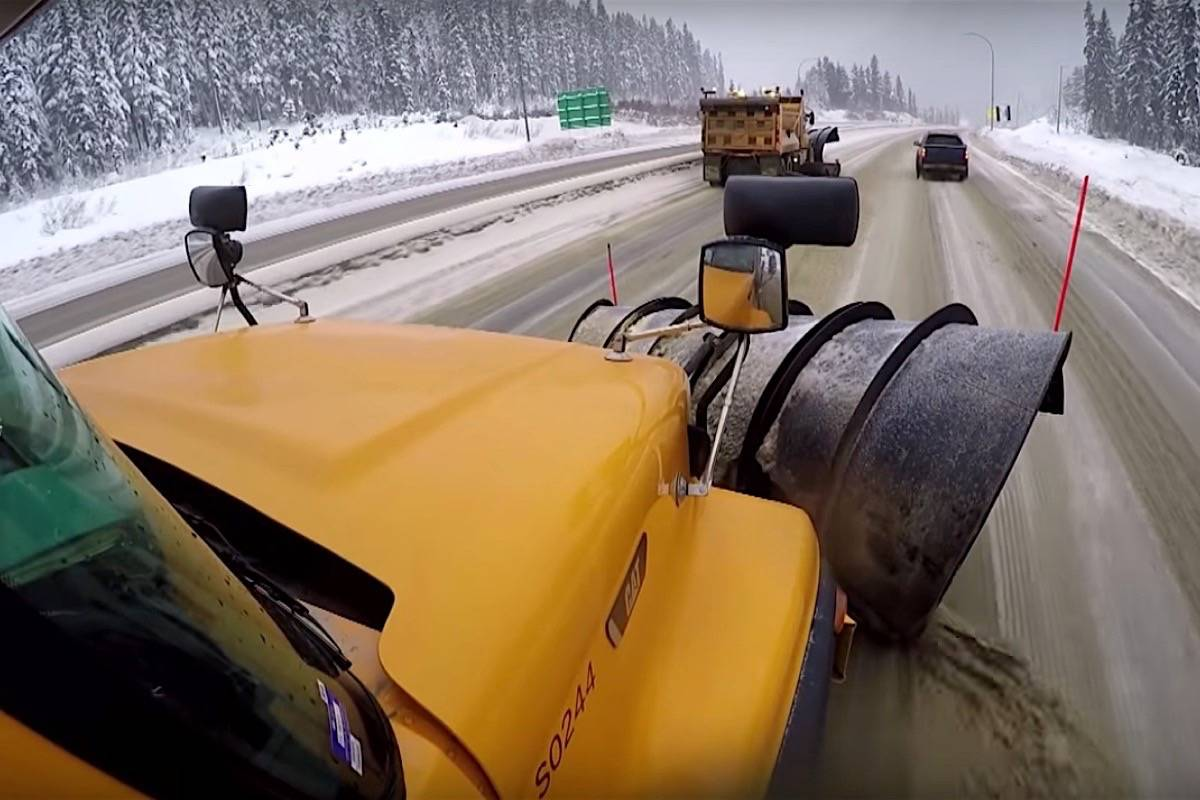 A pickup truck passes a snowplow on the right as two plows work in tandem on a B.C. highway. Drivers are advised to avoid this dangerous move and wait until plows find a safe place to pull over. (Ministry of Transportation)