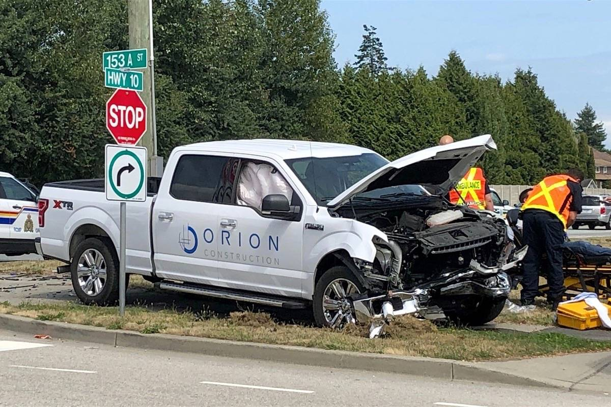 Emergency crews respond to two-vehicle accident on Highway 10 in Surrey, July 31, 2019. (Black Press Media)