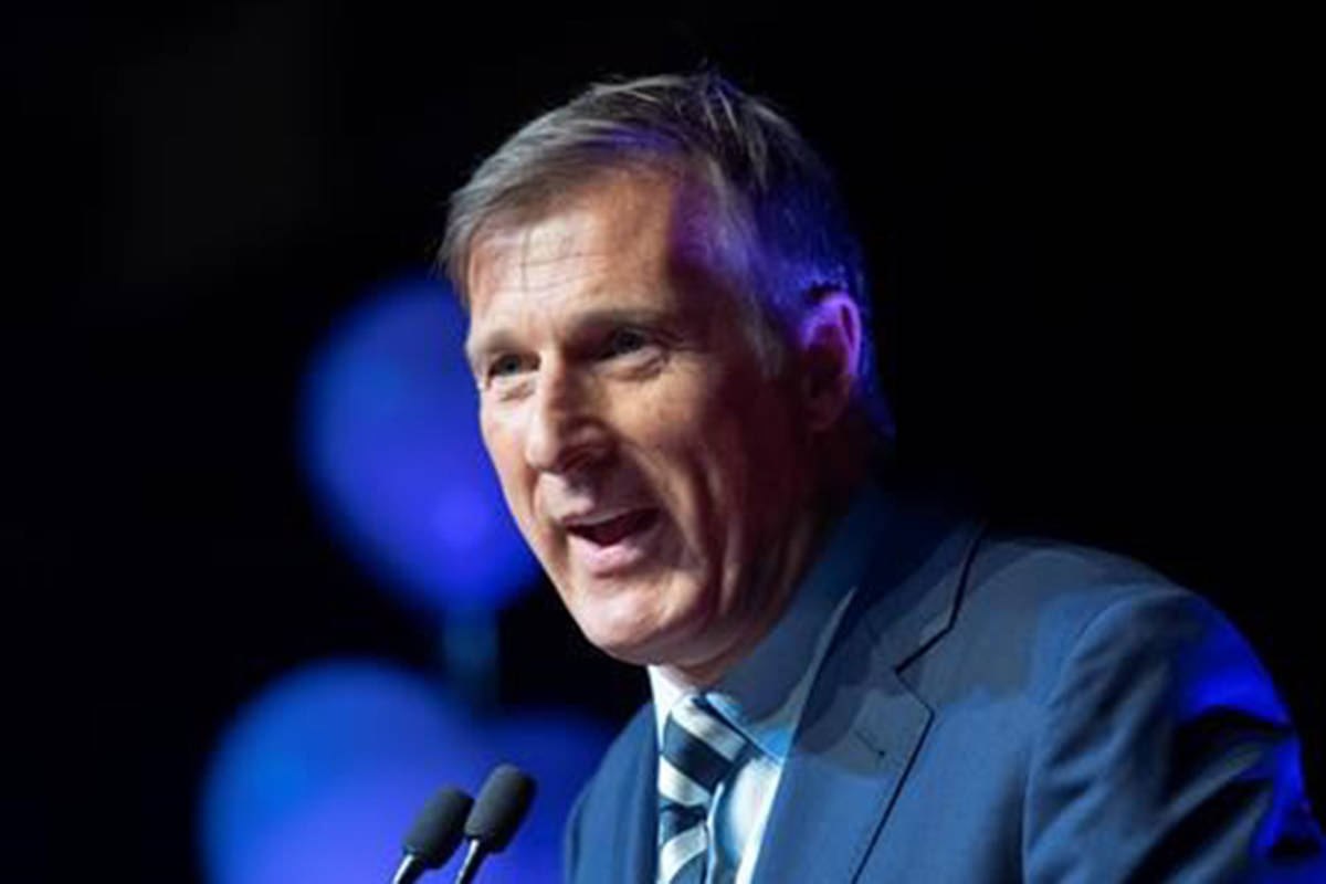 """Maxime Bernier, leader of the People's Party of Canada, speaks at the launch of his campaign Sunday, August 25, 2019 in Sainte-Marie, Que. Bernier is blaming a """"totalitarian leftist mob"""" for the decision to take down billboards promoting his controversial stance on immigration.THE CANADIAN PRESS/Jacques Boissinot"""