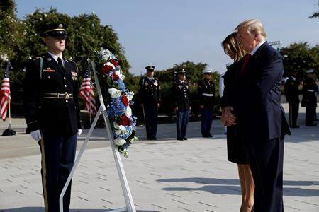 President Donald Trump and first lady Melania Trump participate in a moment of silence honouring the victims of the Sept. 11 terrorist attacks, on the South Lawn of the White House, Wednesday, Sept. 11, 2019, in Washington. (AP Photo/Evan Vucci)