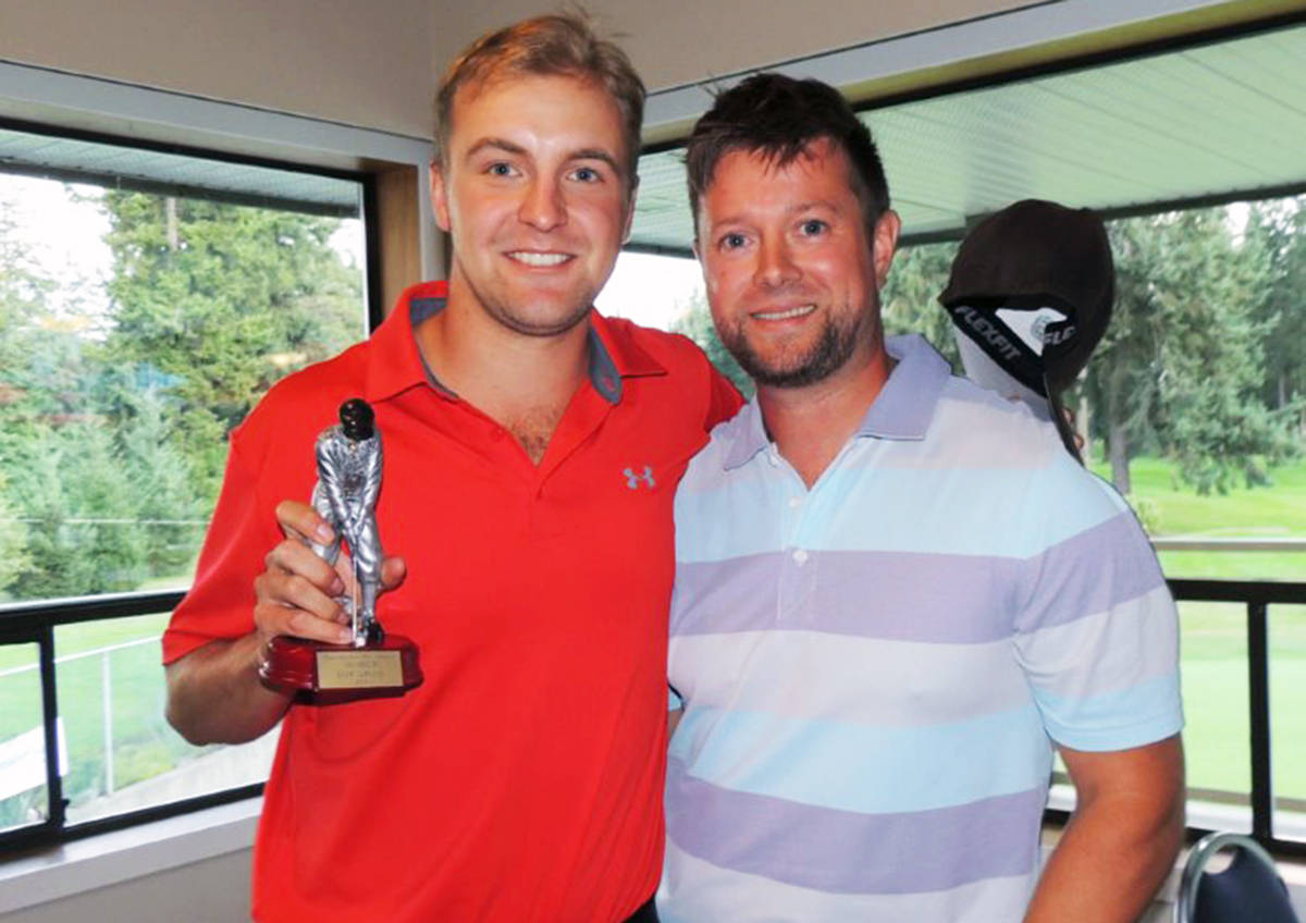 Mount Brenton's top low gross player Matt Tomandl, left, with pro Jan Best during the men's amateur tournament presentations. (Photo submitted)