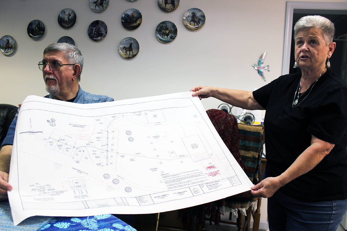 Chemainus River Campground site map is displayed by John and Jeri Wyatt. (Photo by Don Bodger)