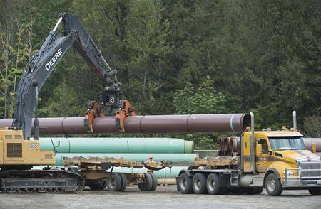 Pipeline pipes are seen at a Trans Mountain facility near Hope, B.C., Thursday, Aug. 22, 2019. (Jonathan Hayward / The Canadian Press)