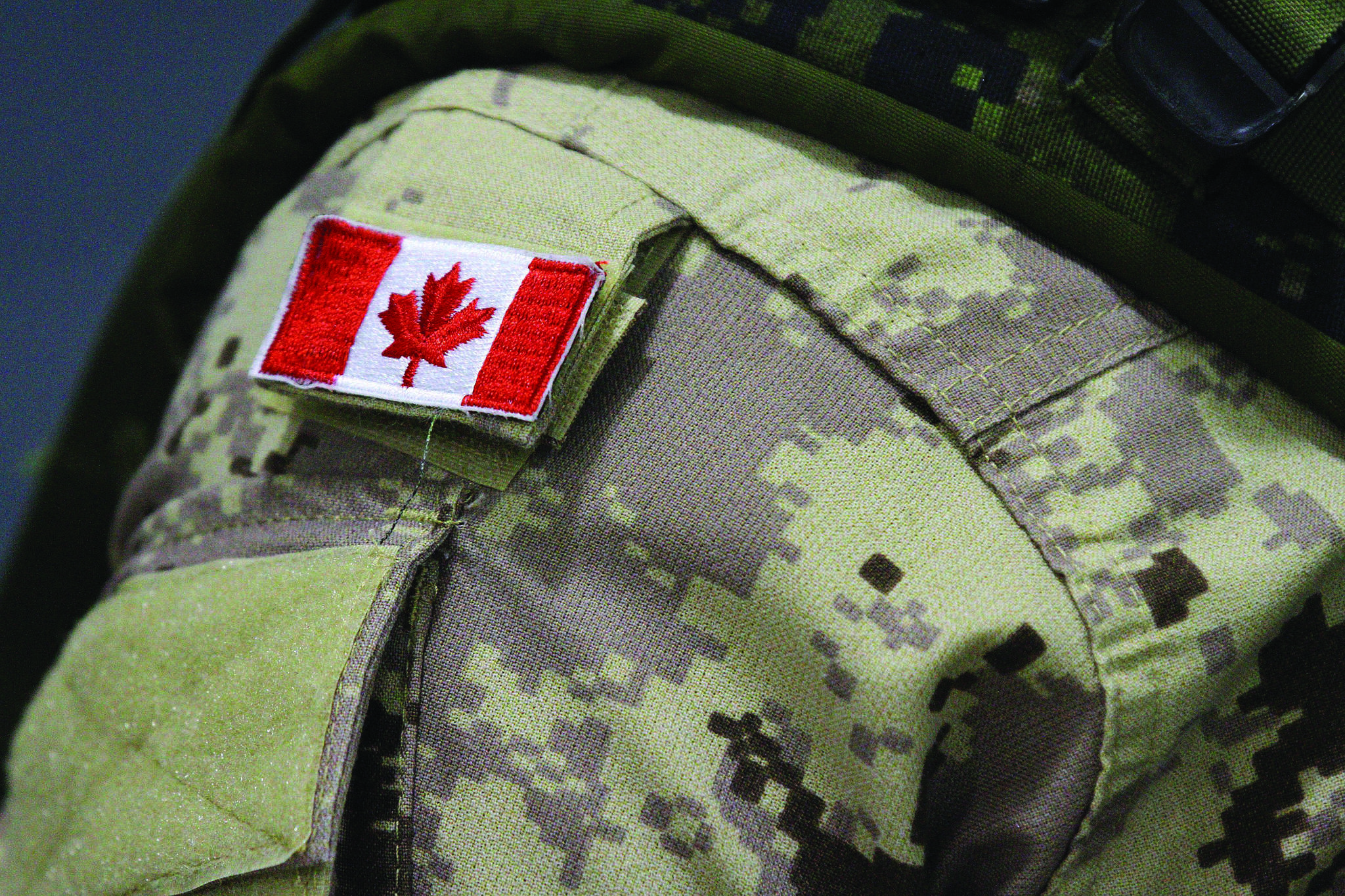 FILE - A Canadian flag is shown on the uniform of a member of the military in Trenton, Ont., on Thursday, Oct. 16, 2014. (THE CANADIAN PRESS/Lars Hagberg)