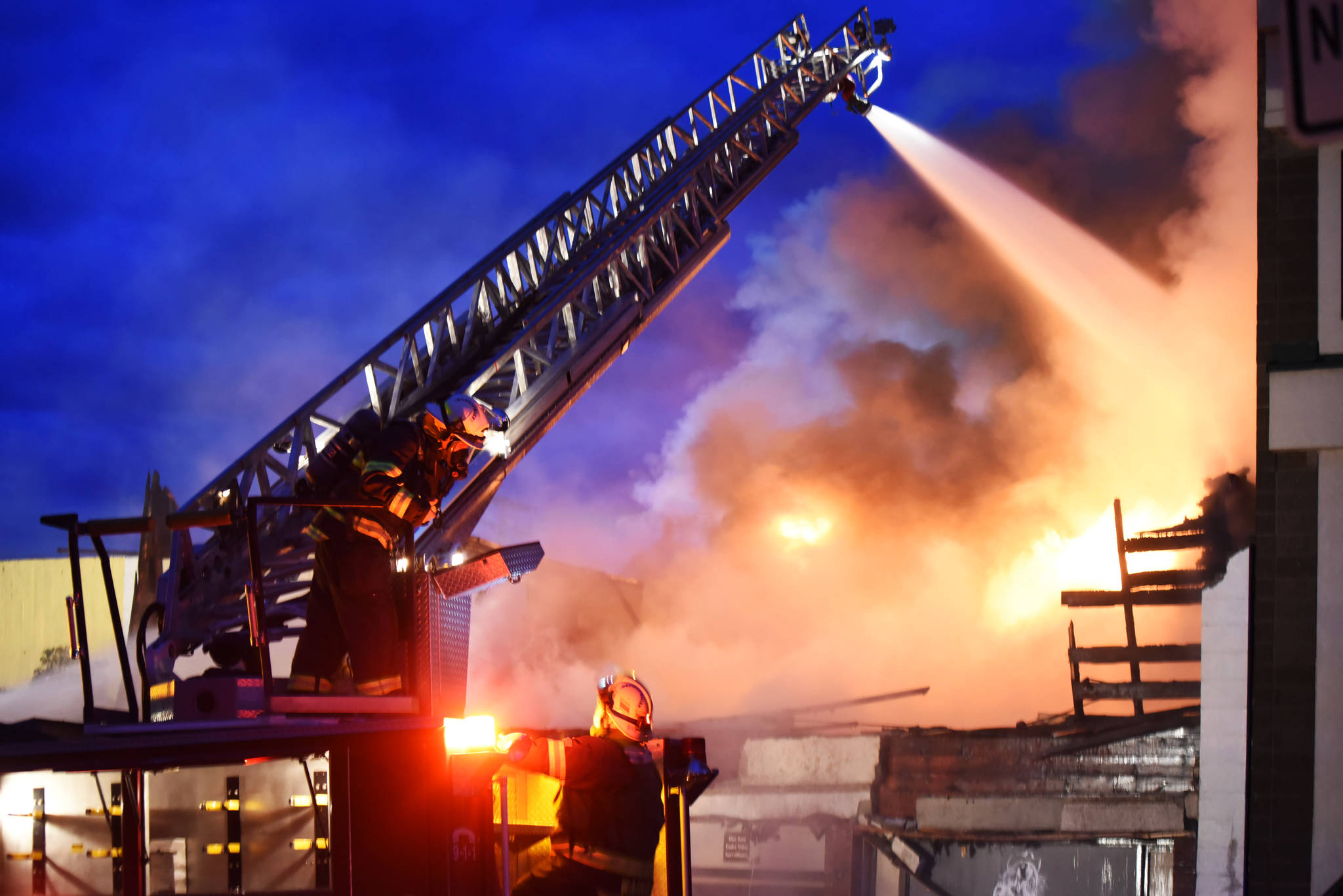 Members of the Williams Lake Fire Department battle a blaze in downtown Williams Lake Friday morning. Angie Mindus photo