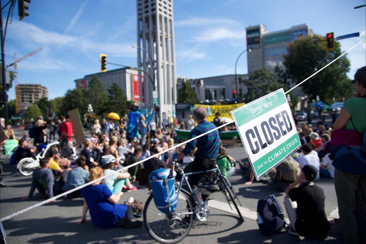 Protesters block traffic in downtown Victoria after student 'climate strike' protest, Sept. 20, 2019. (Victoria News)