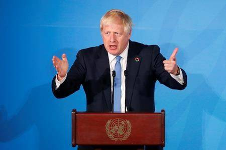 Britain's Prime Minister Boris Johnson addresses the Climate Action Summit in the United Nations General Assembly at the U.N. headquarters, Monday, Sept. 23, 2019. (AP Photo/Jason DeCrow)