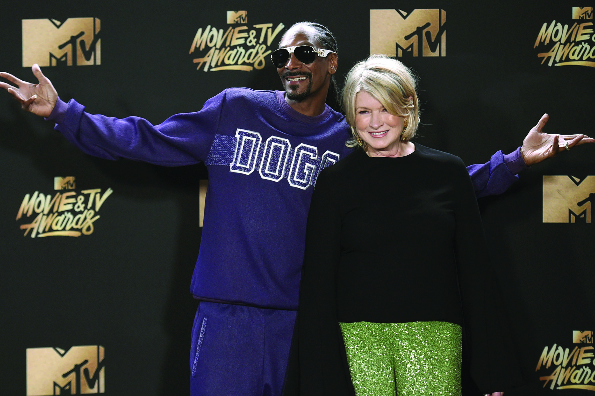 FILE - In this May 7, 2017 file photo, Snoop Dogg, left, and Martha Stewart pose in the press room at the MTV Movie and TV Awards in Los Angeles. The domestic diva said Tuesday, Sept. 24, 2019 that the CBD line of products she is developing with Canopy Growth will likely hit the market in the middle of next year. (Photo by Richard Shotwell/Invision/AP, File)