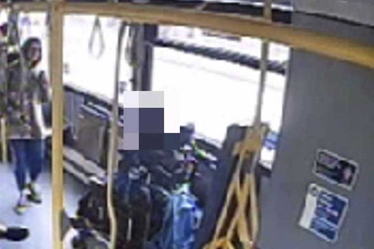 Photo of suspect (at left) aboard a bus in Surrey on Sept. 12.