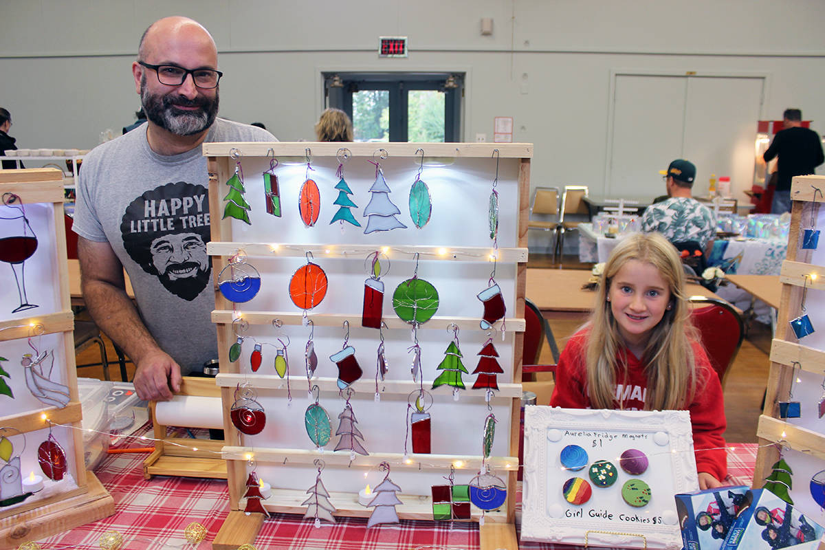 Stephen Gage and daughter Aurelia Gage, 8, a Grade 3 student at Chemainus Elementary School, with a variety of items for sale, including stained glass Christmas decorations. (Photo by Don Bodger)