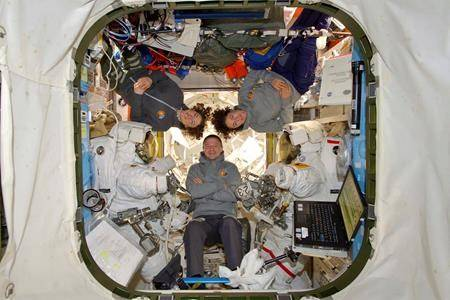 This photo, provided by NASA, shows astronauts Andrew Morgan with Christina Koch and Jessica Meir at the International Space Station on Friday, Oct. 18, 2019. (NASA via AP)