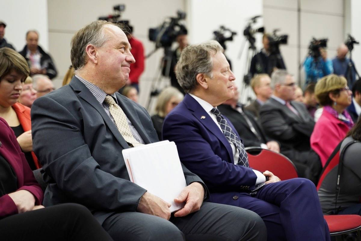 B.C. Green Party leader Andrew Weaver and Environment Minister George Heyman attend ceremony to release CleanBC plan for reducing greenhouse gases in the province, Dec. 5, 2018. (B.C. government)