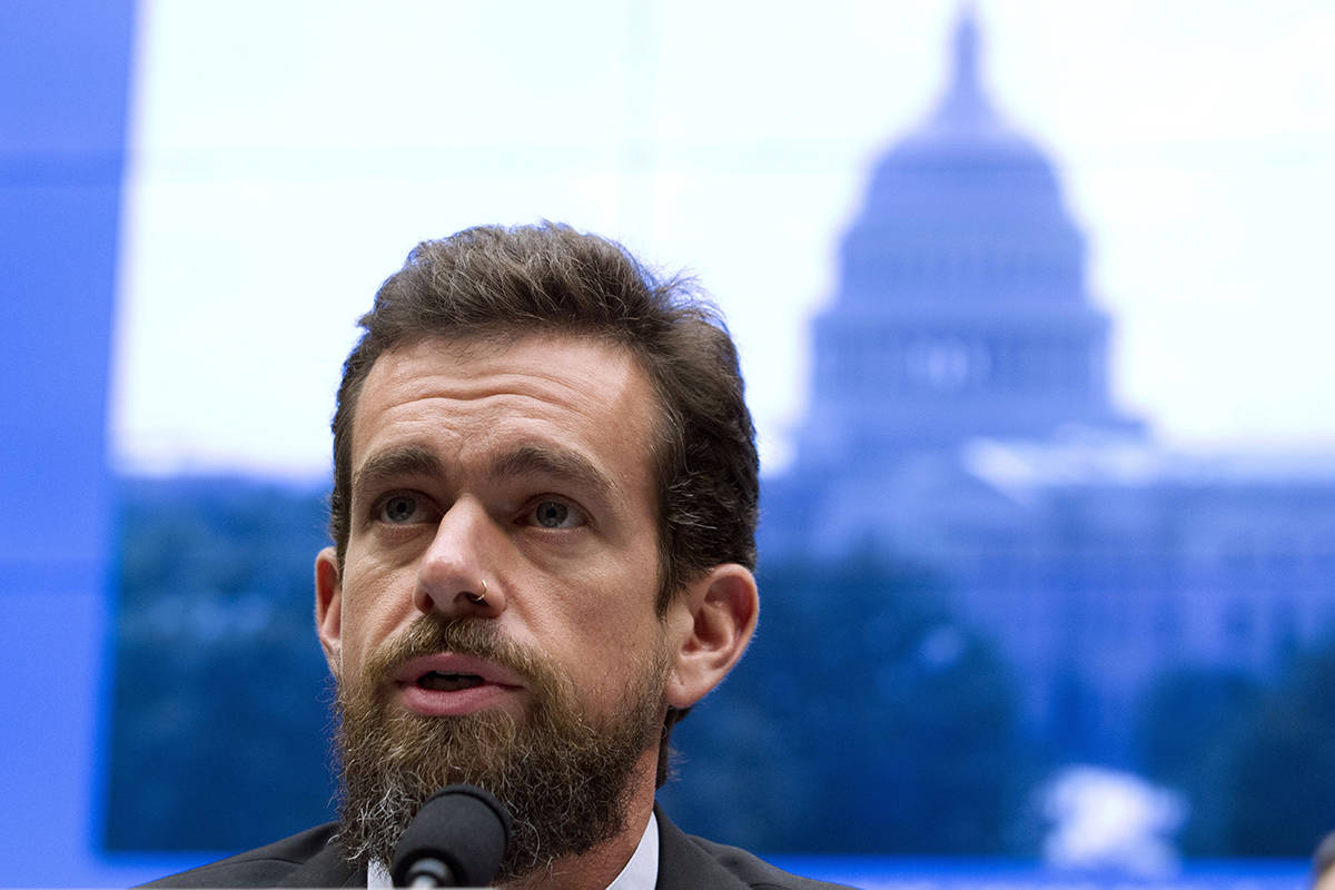 """FILE - In this Sept. 5, 2018, file photo Twitter CEO Jack Dorsey testifies before the House Energy and Commerce Committee in Washington. """"While internet advertising is incredibly powerful and very effective for commercial advertisers, that power brings significant risks to politics, where it can be used to influence votes to affect the lives of millions,"""" Dorsey said Wednesday, Oct. 30, 2019, in a series of tweets announcing Twitters new policy of banning all political advertising from its service. (AP Photo/Jose Luis Magana, File)"""