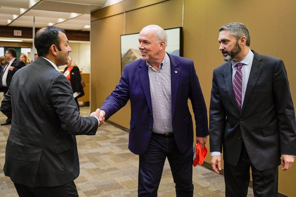 B.C. Premier John Horgan and Yukon Premier Sandy Silver (right) hold meetings in Whitehorse, Sept. 30, 2019, where they agreed to coordinate a shift to daylight time with western U.S. states. (B.C. government)