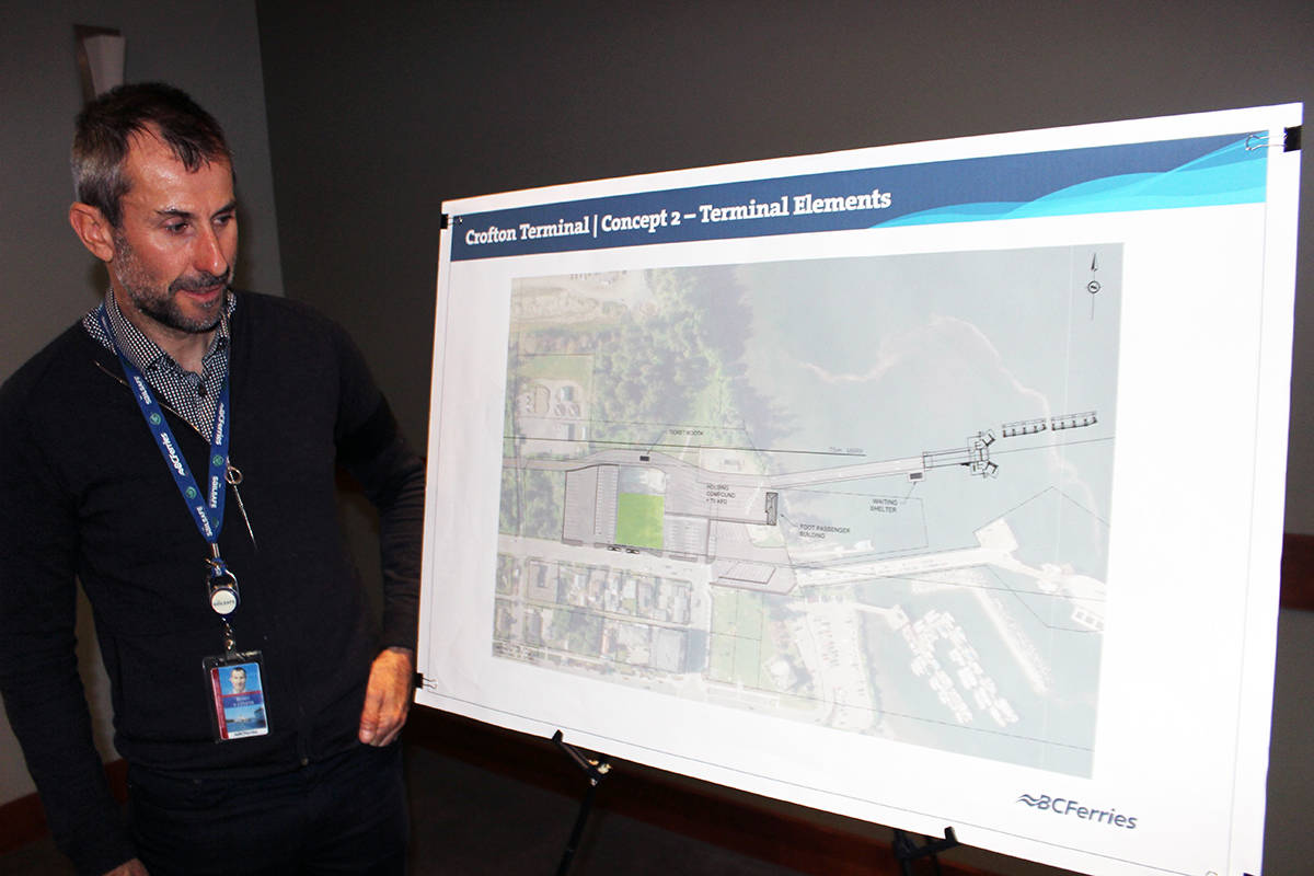 Brian Green, manager of terminal development for BC Ferries, looks over one of the element charts for the Crofton terminal. (Photo by Don Bodger)